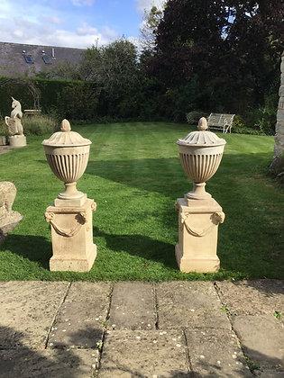 Pair of C18th Coade Stone Urns on pedestals