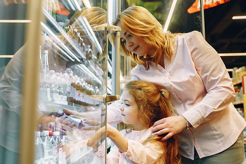 mother-buying-her-daughter-a-bottle-drin