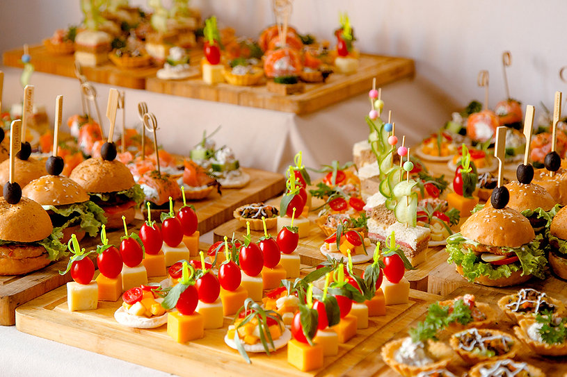 buffet-table-with-snacks-from-burgers-cheeses-etc.jpg