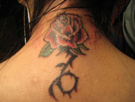 traditional rose cover up tattoo