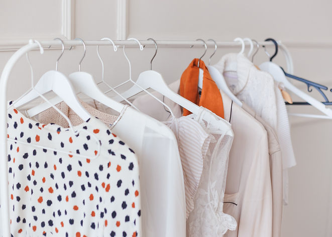 clothes-hang-on-a-shelf-in-a-designer-cl