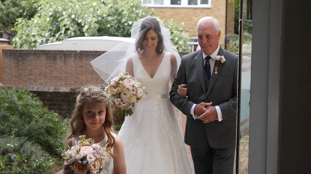Bride and her father walk down the aisle