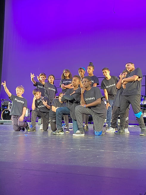 DEAFinitley Crew in various Hip Hop poses at The Strand Theater in Boston, MA.