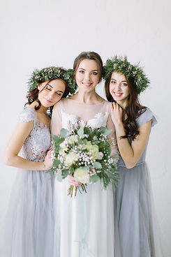 Beautiful laughing bride in a white wedd