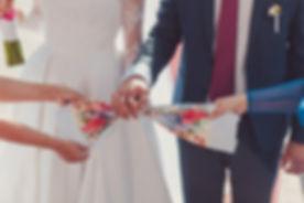 Hands Of Bride And Groom Tied Wedding Towels. The Priest Binds The Bride's Hand Towel. Hands Of Youn