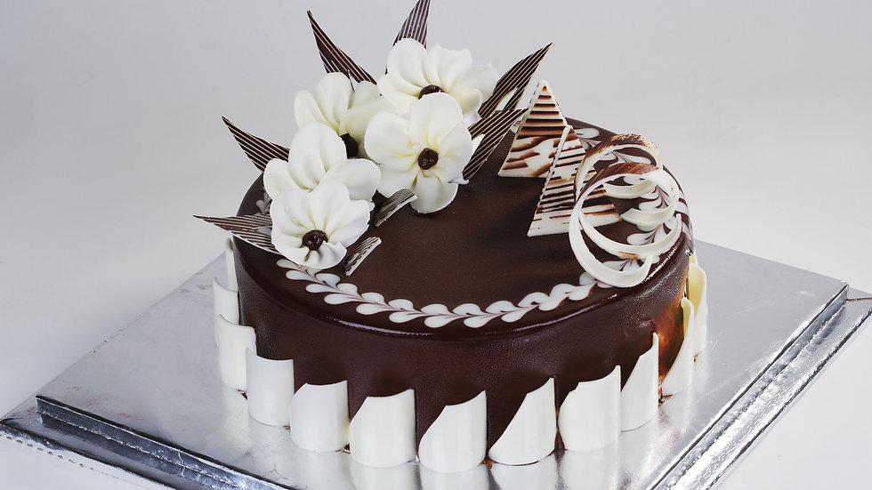 Chocolate Glazed Whipped Cream Frosted Cake