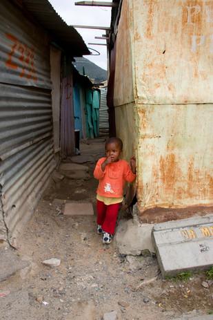 Little orange girl in alley.jpg