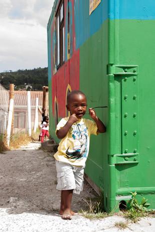 Little boy with plastic.jpg