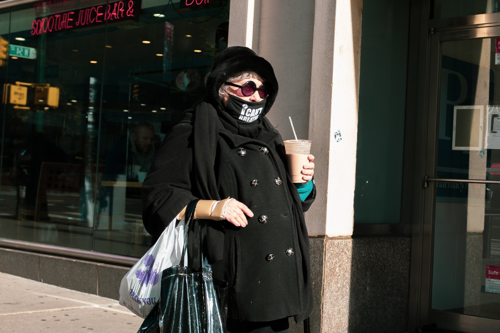 Woman in shades with coffee.jpg