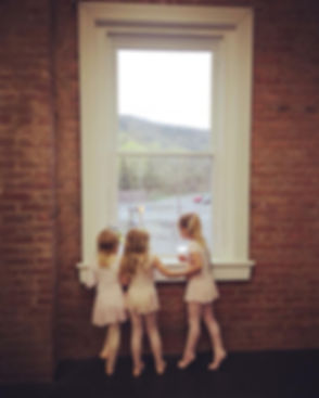 Girls Looking out Studio Window.jpg