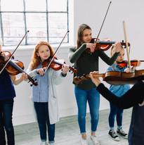 violins violas bows playing.jpg