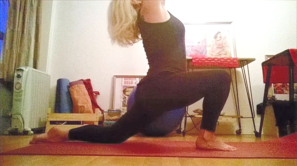 Claudia Steinhauser practicing at home half lunge pose