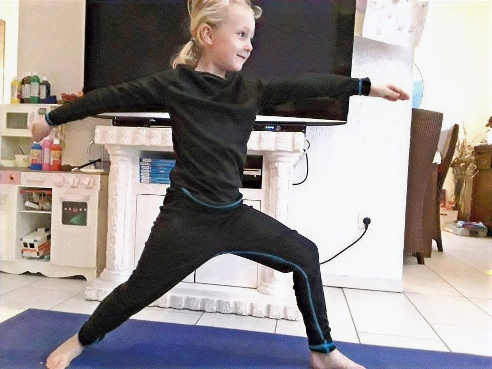 kid doing warrior 2 pose