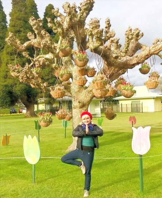 yoga teacher underneath tree in rotorua