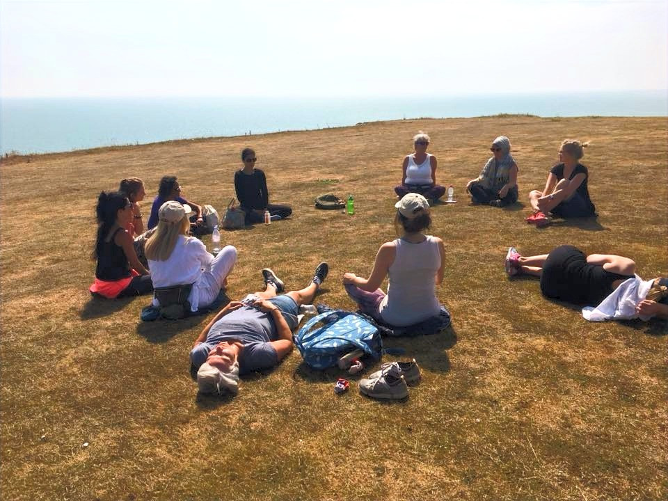 yoga retreat - people on top of the seven sisters meditating