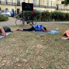 Outside yoga with yoga teacher trainees
