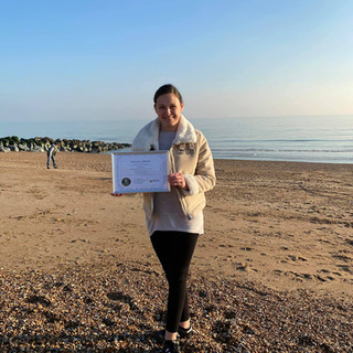 Excellent Yoga Teacher receiving her certificate