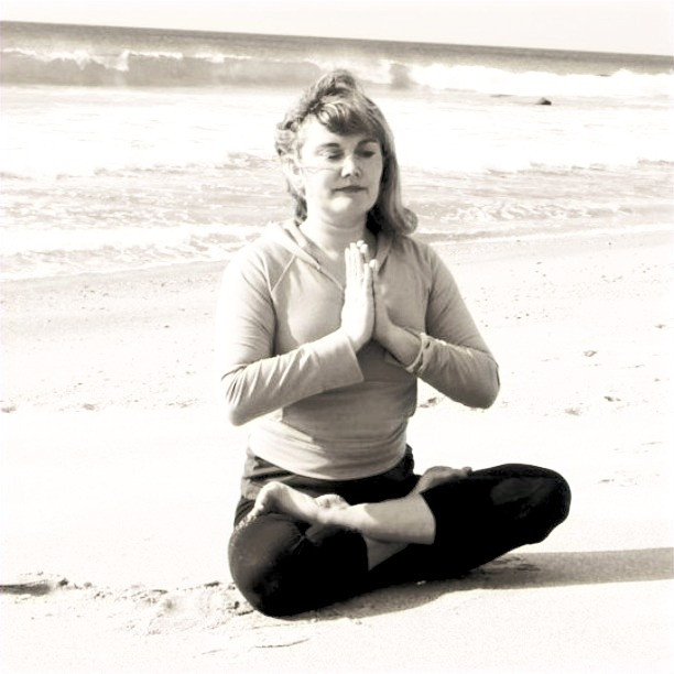 yoga teacher at a beach
