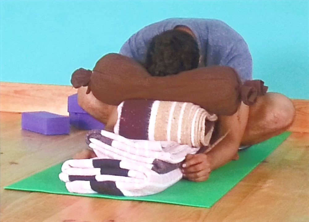 student practising restorative yoga on yoga retreat