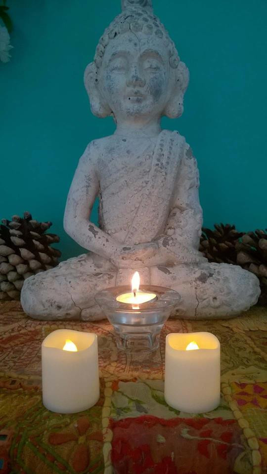 buddha with two candles