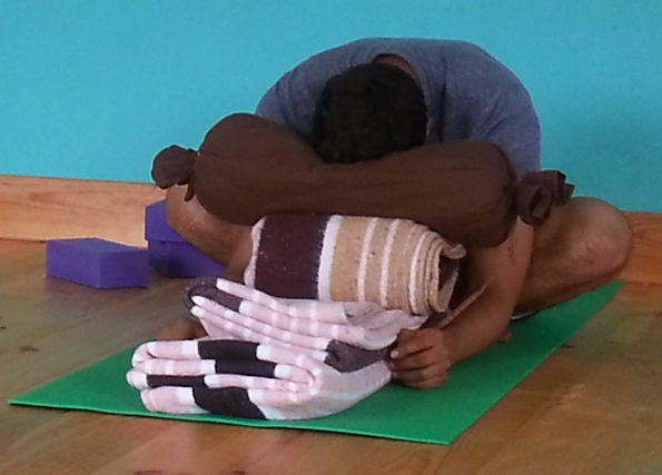 Man doing restorative yoga