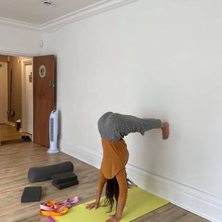 Yoga Teaching Trainee practicing inversions