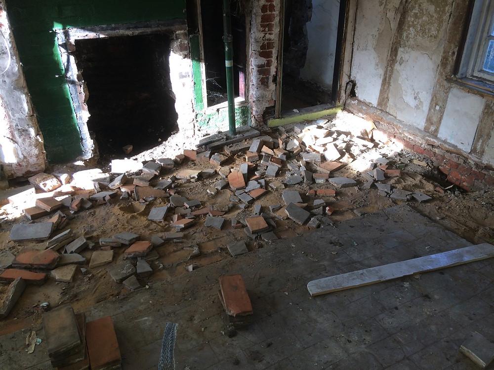 Old brick floor being taken up