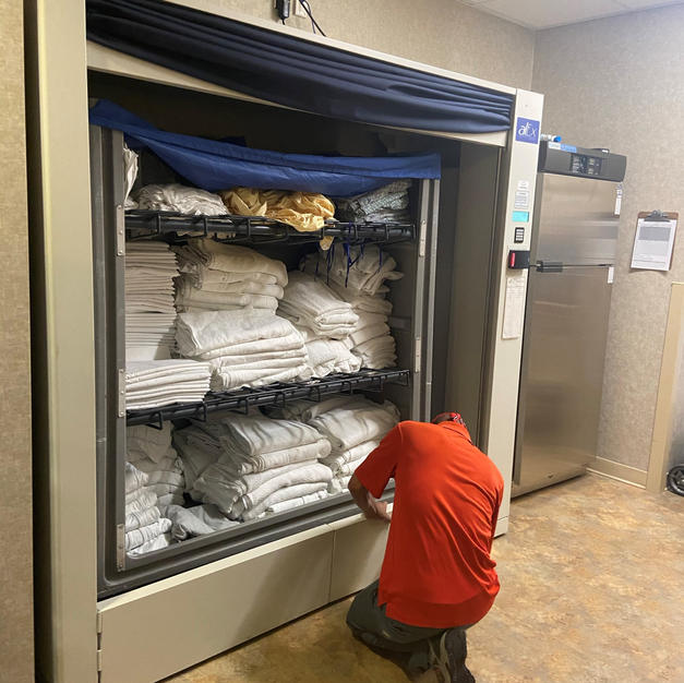 First Generation alEx Linen Exchange installed at AnMed Health Medical Center in 2010. (Requires hospital exchange cart)