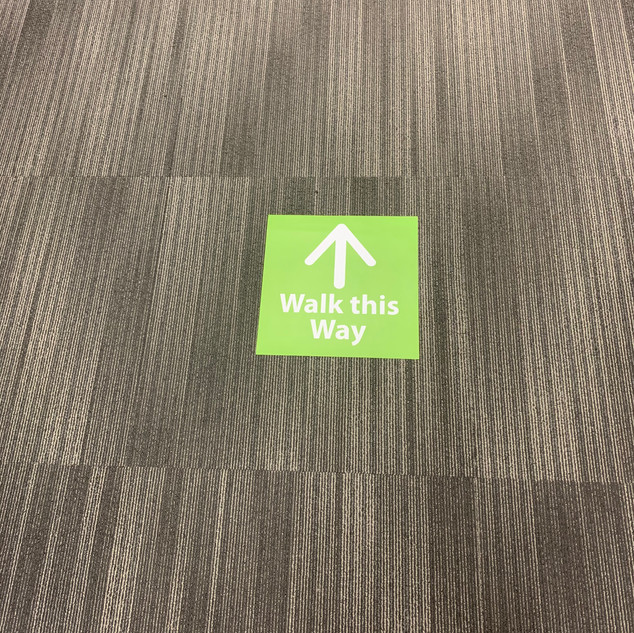 Floor directionals throughout the office to encourage the flow of office traffic