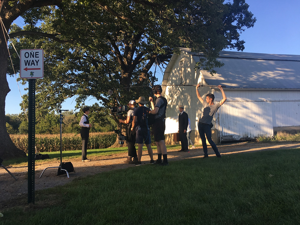 Set photo from Jack and Anna showing the crew filming a scene.