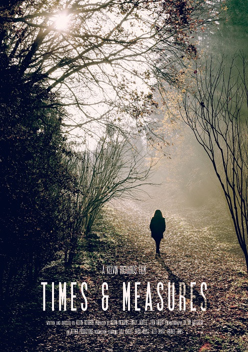 Times & Measures movie poster featuring a wood with natural sunlight coming through the trees and a single figure walking.