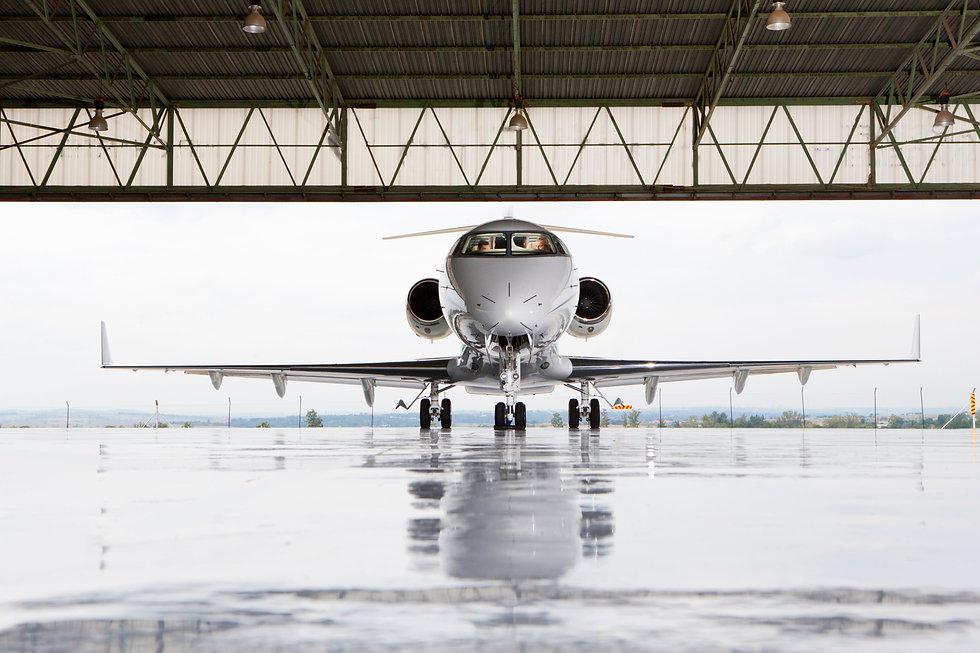 Pilots in private jet in hangar.jpg