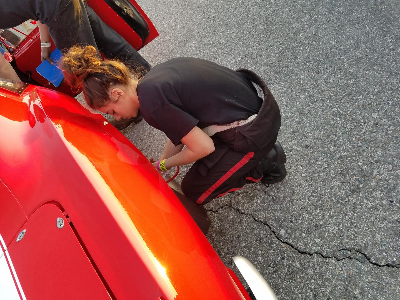 Hannah Maloof setting the tire pressure