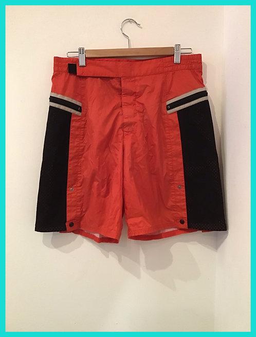 Orange Fila shorts