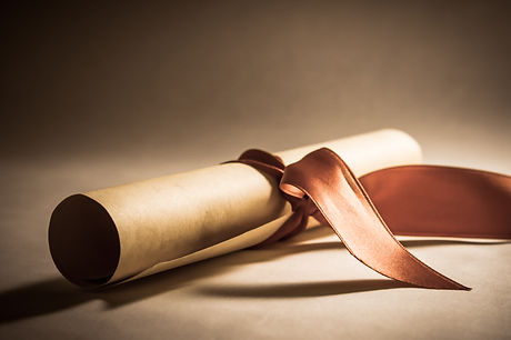 A parchment diploma scroll, rolled up wi