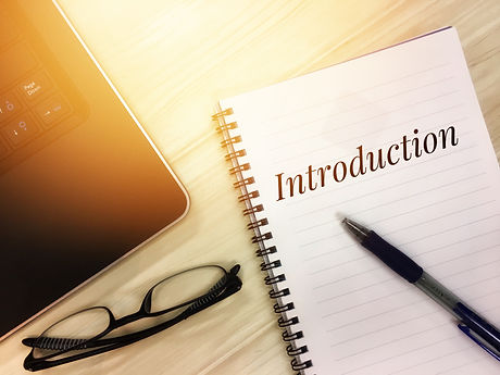 Introduction words on notepad. Business