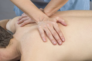 Physiotherapist Doing A Back Massage To