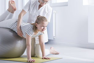Girl Performs A Stretch Exercise.jpg