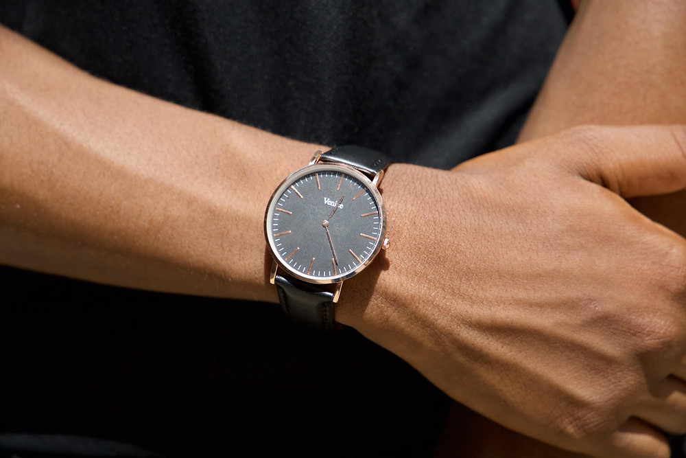 Close up of the watch, one of the products at Eterno Watchwear. The watch is being worn by a model.