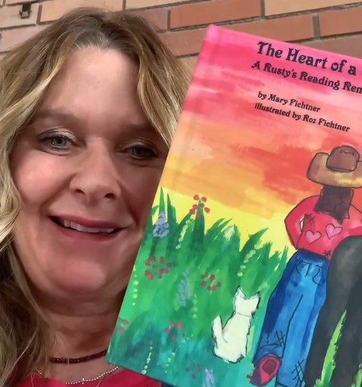 Mary Fichtner holding her new cowgirl book