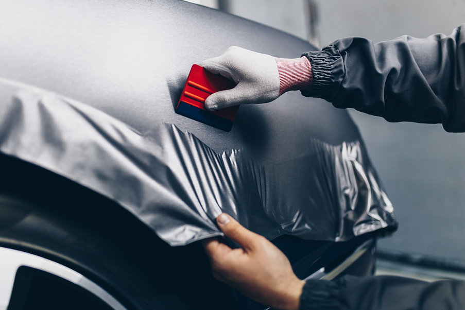 Car wrapping specialist putting vinyl fo