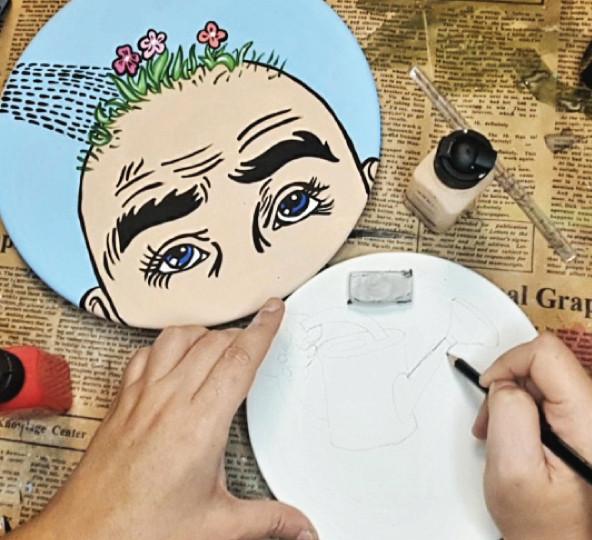 ציור על צלחת קיר