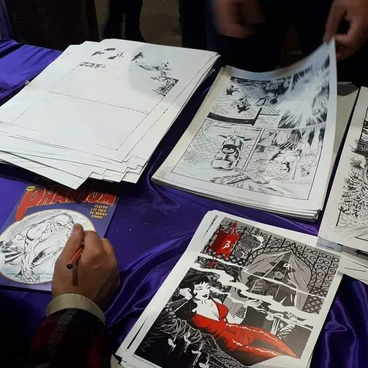 Phan browsing original art