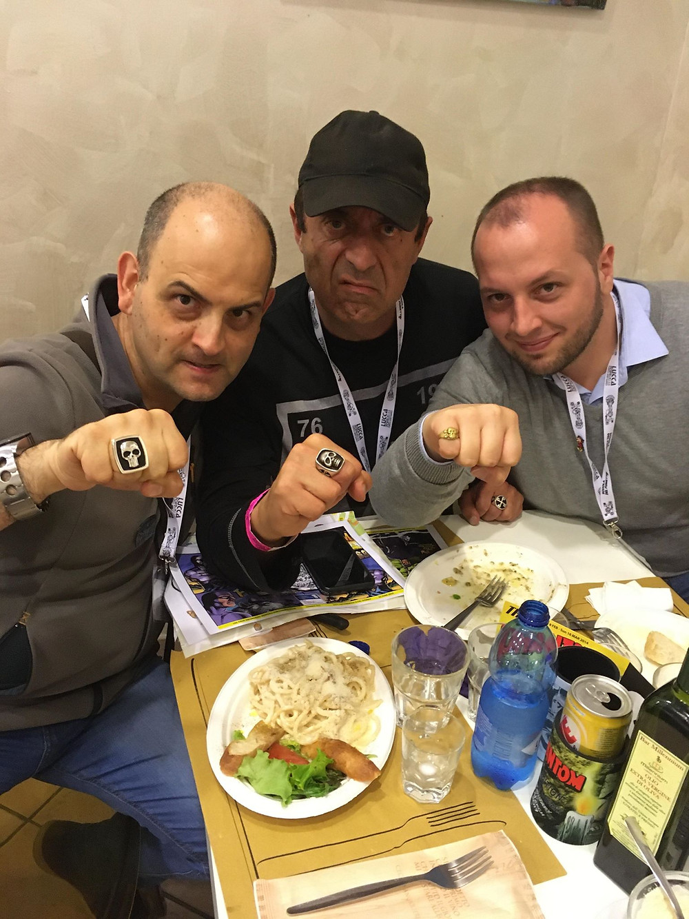Massimo Gamberi, Sal Velluto and Luca Giorgi catch up at the Lucca Comics and Games convention 2019.