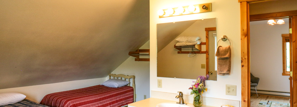 Upstairs bedroom with 3 twin beds
