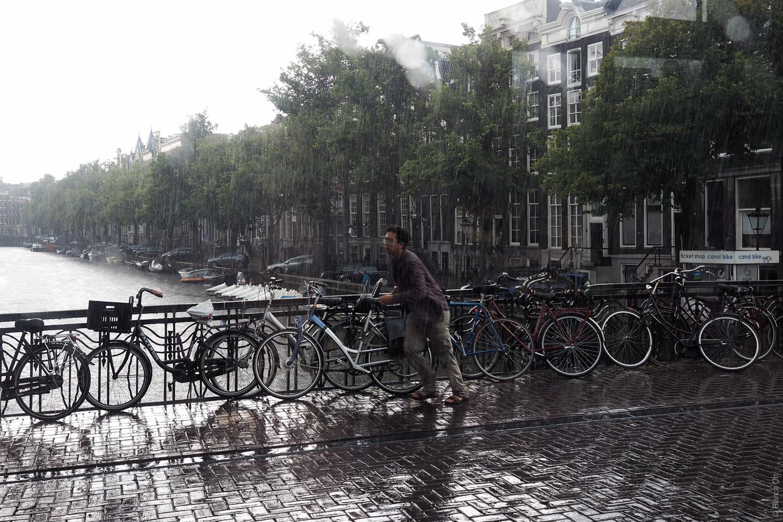 Mann_Regen_Fahrrad