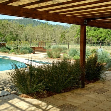 Poolside native plantings with pergola & bocce court