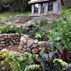 Stone Keyhole Garden with Potting Cottage