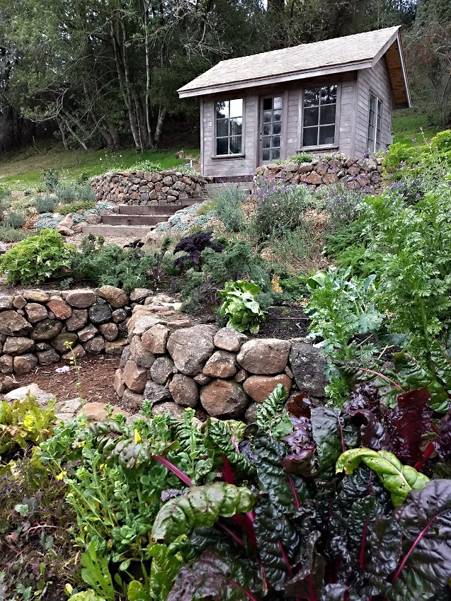 Stone Keyhole Garden with Potting Cottage