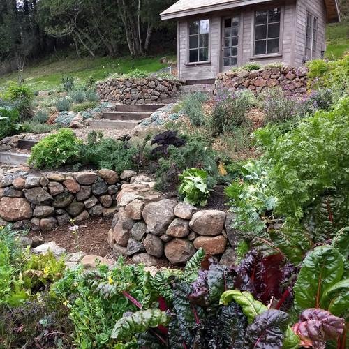 Stone keyhole garden for veggies, herbs & pollinator plants